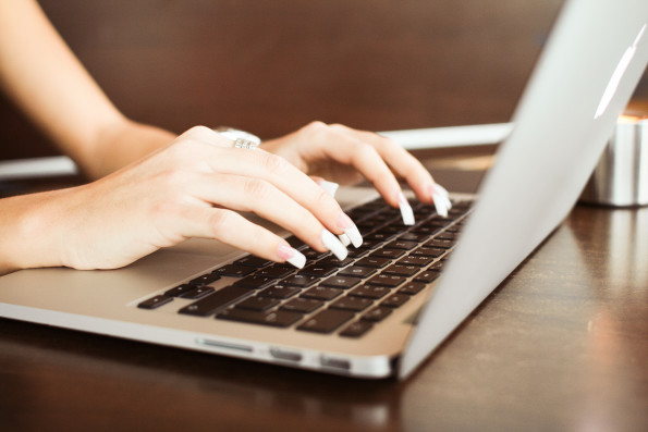 Writer Creating Content on Laptop